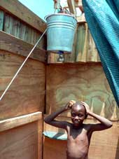 Boy Using Bucket Shower