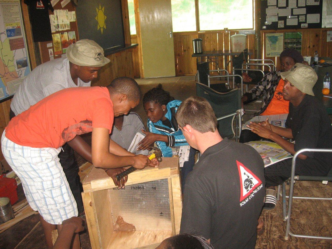 Participants making solar ovens