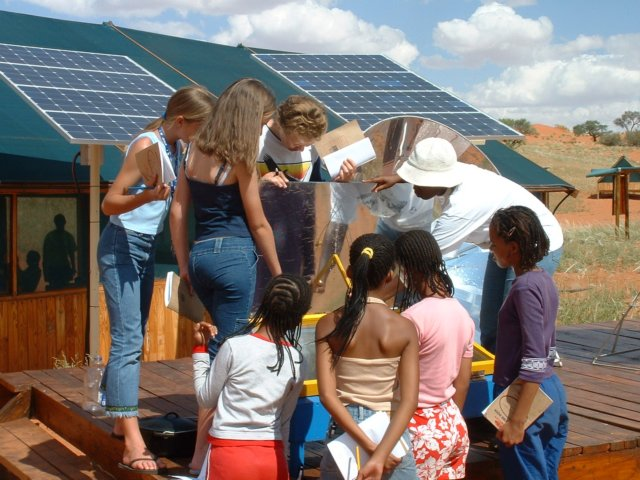 Learners inspect how solar energy is reflected into the oven