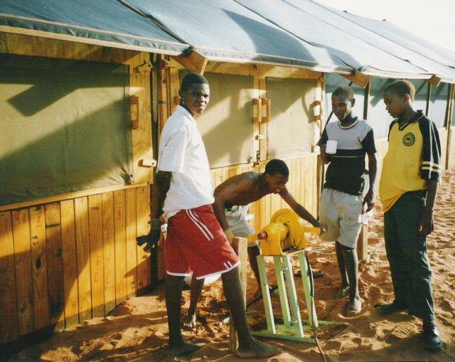 Boys pumping sewage