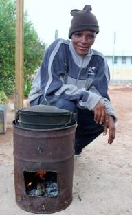 Man with fuel efficient stove