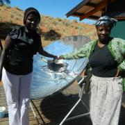 Women solar cooking traditional food