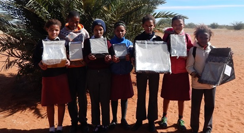 Grade 6 children from Gochas construct solar ovens